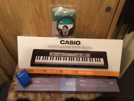 Casio CTK1550 synthesizer with stand and headphones. brand new, unused