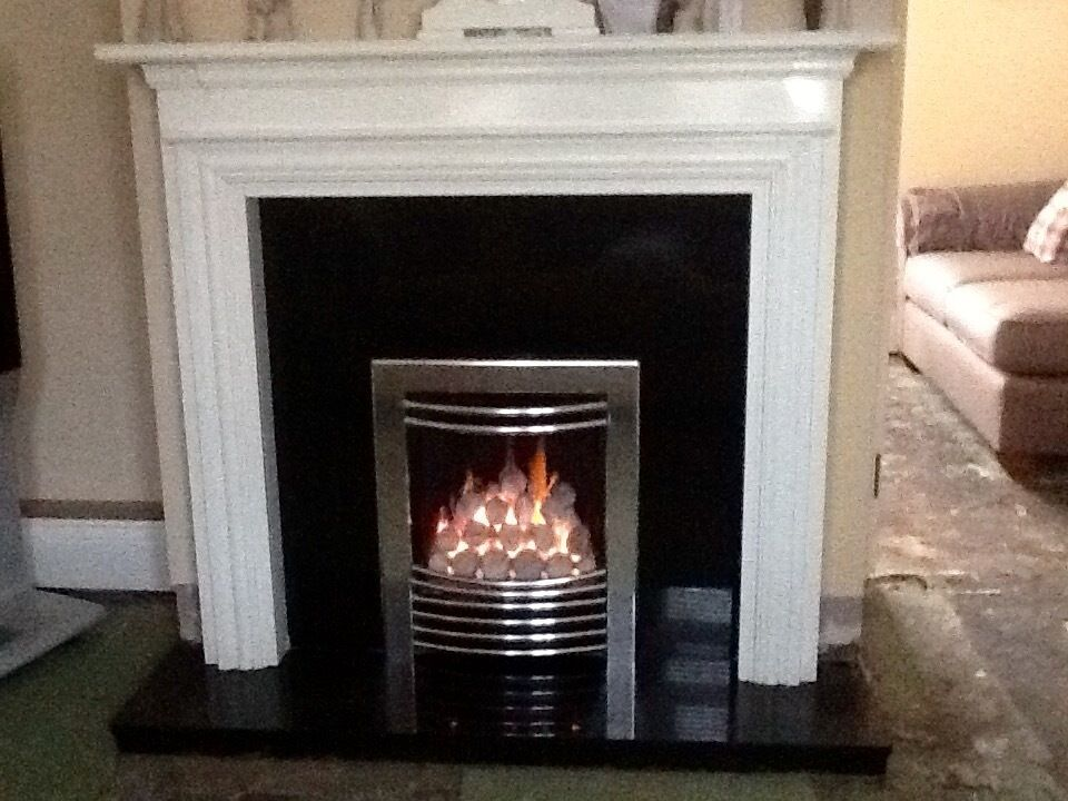 Stunning white fire surround black granite back panel hearth chrome gas fire excellent - Black and white fireplace ...