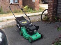 Power base petrol lawn mower