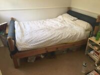Wooden double bed frame with upholstered head and foot board - no mattress