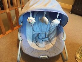 Blue vibrating baby chair with sound
