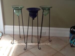 Wrought iron candle holders. Two feet tall.