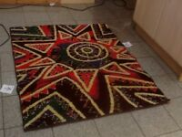 Acrylic rug lightly used for 4months 144cmx117cm-slight stitching coming away hence £10-see 9 photos