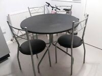 Black kitchen table with 4 chairs