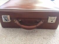 Retro brown suitcase with vanity compartment
