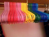 67 kids coat hangers of various colours