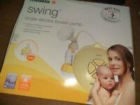Medela swing single electric breast pump with calma teat