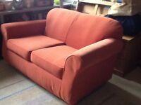 Two seater sofa - terracotta colour - good condition