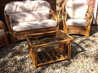 Cane furniture. Sofa, two armchairs and coffe table in good , clean condition.