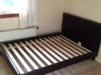 Brown faux leather double bed.
