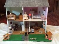 Dolls house with dolls and furniture