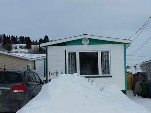 Maison mobile à La Baie sous l'évaluation municipale