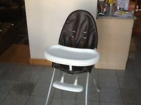 Highchair wth detachable tray/table and harness-2 of the legs have some plater splash stains
