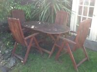 Heavy solid garden table and four chairs