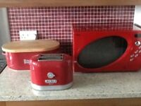 A MICROWAVE, A TOASTER AND BREADBIN ALL IN RED