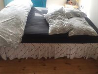 Double bed with orthopaedic mattress