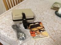 Kenwood sandwich maker complete with the lead and recipe/instruction booklet