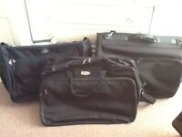 Black canvass suit/luggage bags hardly or never used, lightweight, excellent for carry on etc