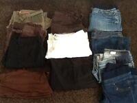 A bundle of maternity clothes size 12/14