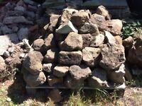 Rockery stone and broken York paving slabs