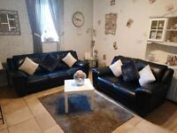 Stunning DFS Real Genuine Leather Black 3 seater and 2 seater sofas very stylish modern design
