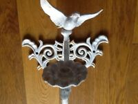 A vintage cast iron dove candle wall sconce/stick