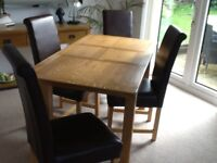 Four Leather and light Oak Dining Chairs