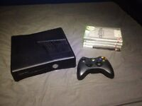 Xbox 360 S With 4 Games, Controller, and Wires