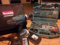 Makita 18v 1.3 ah combi-drill, 2 batteries + recharging station, and 101 piece makita drill bit set