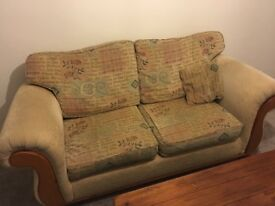 Sofa and two matching arm chairs and foot rest