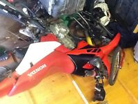 xr kxf yzf crf cg wr 125 for sale, needs back swinging arm, but can be showed started.