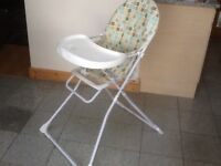 Highchair with fold-over tray/table-padded plastic covered seat-easy to wipe down-folds down