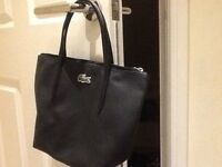 Ladies genuine Lacoste black small handbag