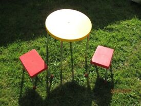 small kids round yellow table and red little stools great for in the garden or bedroom