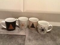 4 black .white& gold mugs new boxed