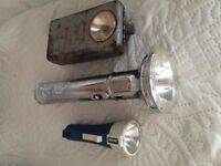 Three old vintage torches.