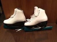 Girls white ice skates.