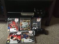 PS3 with 3 controllers plus games!