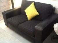 Black leather and chenille 2 seater sofa