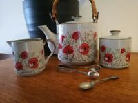 Vintage Japanese tea set with nickel silver spoon and silver-plated sugar tongs.