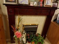 Mantelpiece / Fire Surround in wood-effect hardboard colour of Mahogany