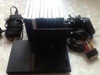Ps2 slim with 10 games and accessories