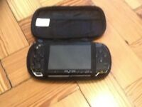 Sony PSP with charger and numerous games and movies