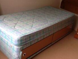 Single devan bed with Dreamworld Dunster 13g system mattress has full size storage under
