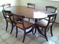 Extendable maghony dining table and 6 chairs with gold material seats