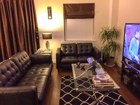 Black Leather sofa one large and one regular very condition