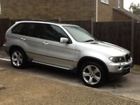 BMW X5 immaculate for year,full service history,new mot,sat nav,tv,cd multi changer,met silver