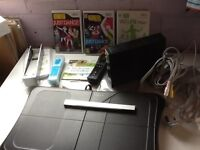 Nintendo Wii console with several games.