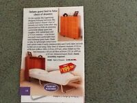 Store away single fold away bed for sale, folds into a wooden chest