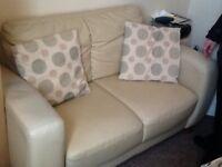 Faux leather sofa.